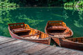 Traditional wooden boats at forest lake pier Royalty Free Stock Photo