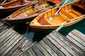 Traditional wooden boats on Lake Bled, Slovenia. Royalty Free Stock Photo
