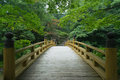 Traditional wooden bridge in old Japanese garden, Kyoto Royalty Free Stock Photo