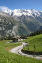 A traditional wooden hut under the foot of the alps in switzerland Stock Images