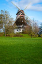 Traditional wooden windmill in a lush garden Stock Photography