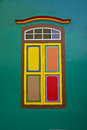 Traditional wooden window with leaf doors closed and colourful combination Royalty Free Stock Photo