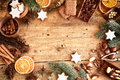 Traditional xmas frame with spices and nuts speculoos biscuits star cookies assorted decorated dried orange around central Stock Photos