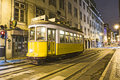 Traditional yellow tram downtown lisbon portugal december lisbon by night on december trams are used by everyone and also keep the Royalty Free Stock Photos