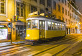 Traditional yellow tram downtown lisbon portugal december lisbon by night on december trams are used by everyone and also keep the Royalty Free Stock Photo