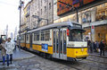Traditional yellow tram on the street of milan italy december atm class tramway network operation since network is now about km Royalty Free Stock Image