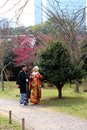 Traditional young japanese couple out for a stroll in the park during the spring love downtown tokyo march Royalty Free Stock Images
