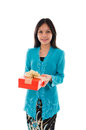 Traditional young malay girl holding a gift photo Stock Photography