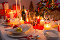 Traditionally set table for christmas eve in home Royalty Free Stock Image