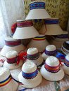 Traditionals small hats exposed to pyramid of the region of the Maramures in Romania. Royalty Free Stock Photo