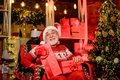 Traditions concept. Legend about Santa Claus. Merry christmas. Elderly grandpa at home. Delivering gifts. Presents for Royalty Free Stock Photo