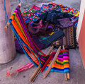 Traditonal loom for weaving with hand woven clothing for sale on bright cotton colors on the corner of a street in guatemala Royalty Free Stock Images