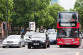Traffic in central london a double decker bus to paddington a bmw suv and a mercedes car wait for the green light marleybone rd on Stock Photography