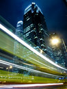 Traffic in Commercial Landmark at Night Stock Image