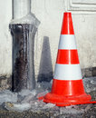 Traffic cone at a sidewalk Stock Photos