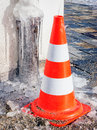 Traffic cone at a sidewalk Royalty Free Stock Photos