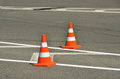 Traffic cones on the gray asphalt in the city Stock Photo