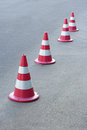 Traffic cones a line of red along the road Royalty Free Stock Photography