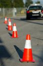 Traffic cones set up to direct traffic around a police car Stock Image