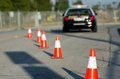 Traffic cones set up to direct traffic around a police car Royalty Free Stock Photography