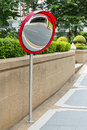 Traffic convex mirror close up near car park entrance Royalty Free Stock Images