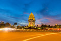Traffic drives around the independence monument in downtown phnom penh cambodia Royalty Free Stock Photography