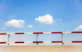 Traffic fence dangerous beside street with blue sky for safety Royalty Free Stock Photo