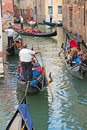 Traffic of gondolas in venetian canal, Italy Royalty Free Stock Photo