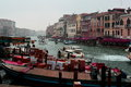 Traffic on the grande canal venice italy amazing city of draws millions of visitors yearly to its famous rialto bridge to its Royalty Free Stock Images