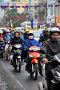 Traffic in Hanoi. Crowd of motorbike drivers on the street Royalty Free Stock Photo