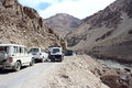 Traffic jam in mountain tourist car on a narrow muddy road ladakh india Stock Photo