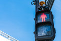Traffic light with red sign for walkers to stop  . Royalty Free Stock Photo