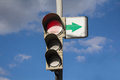 Traffic light and sign with arrow Royalty Free Stock Photo