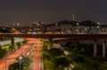 Traffic light trails on motorway highway at night in Seoul ,Sout Royalty Free Stock Photo