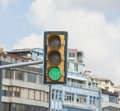 Traffic light in urban city center system on green environment Royalty Free Stock Images