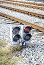 Traffic light via train rail signaling for entry into station Stock Photo