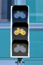 Traffic lights for cyclists with yellow signal Royalty Free Stock Photo