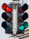 Traffic lights with red and green light a at an intersection Stock Photos