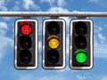 Traffic lights - red yellow green against sky