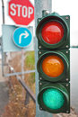 Traffic lights with road signs Royalty Free Stock Image
