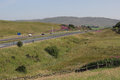 Traffic on quiet motorway in countryside cumbria light with no heavy goods vehicles a three lane m england with moorland and hills Royalty Free Stock Photos