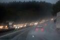 Traffic on the rainy autobahn Stock Photos