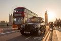 Traffic and random people on Westminster Bridge in sunset, London, UK. Royalty Free Stock Photo