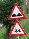 Traffic road signs caution in europe Stock Images