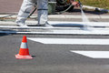 Traffic series renew the road marking on the street real workers Stock Photos