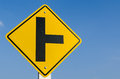 Traffic sign crossroads on blue sky Stock Images