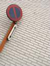 Traffic sign in front of wall with white tiles Royalty Free Stock Photography