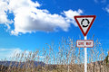 Traffic sign over dry grass and blue sky Stock Images