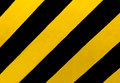 Traffic Sign: A rectangular sign with diagonal yellow and black stripes, wherever there is a median or other obstruction.