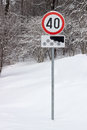 Traffic signs for maximum speed km per hour at winter with note only when is the snowy road Stock Photo